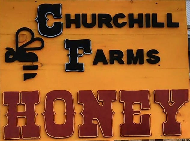 Churchill Honey Farm logo.
